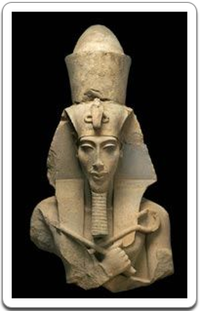 Head and torso of a colossal statue of the 'heretic' pharaoh Akhenaten.