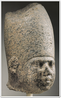 Granite head of an unnamed king.