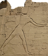 Thutmosis III slaying his enemies on the VIIIth Pylon of the temple of Amun-Re at Karnak.